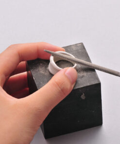 Filing on Rubber Block